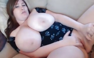 Hot bitch with giant boobs is fingering her shaved clean vagina