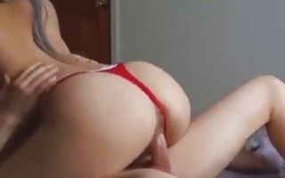 Hot babe wearing her panties only riding this huge massive dick