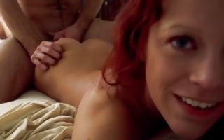 Cute red-haired babe gets that round booty slammed doggy style