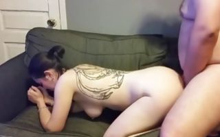 Brunette babe with a slutty tattoo gets pussy slammed from behind