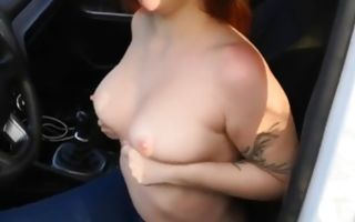 Long haired ginger whore blows cock in the car and gets fucked