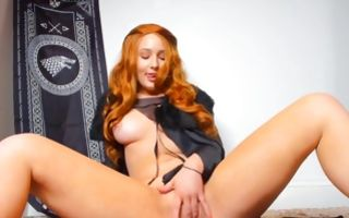 Ginger babe spreads out her legs fingering her vagina