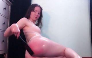 Teen brunette fucking her anus with huge dildo