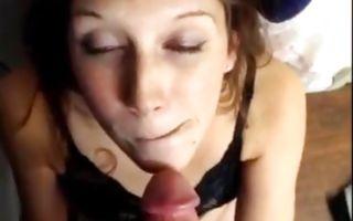 Teen brunette on her knees swallowing a fuck stick