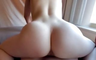 Hot babe riding a huge dick exposing her booty