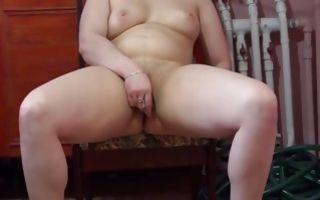 Totally naked fat brunette masturbating