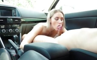 Slutty blonde with fake tits gives a blowjob to a huge ramrod