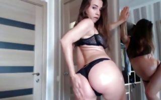 Naughty brunette girlfriend in underwear fucks herself with a dildo