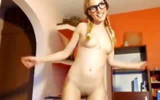 Raunchy blonde with a big breast fingers her clit in solo