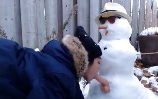 Naughty brunette girlfriend sucks a dildo of a snowman