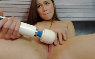 Young petite brunette rubs her clit with a vibrator cumming loud