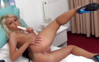 Curly-haired blond bitch in heels shows and plays with muffin